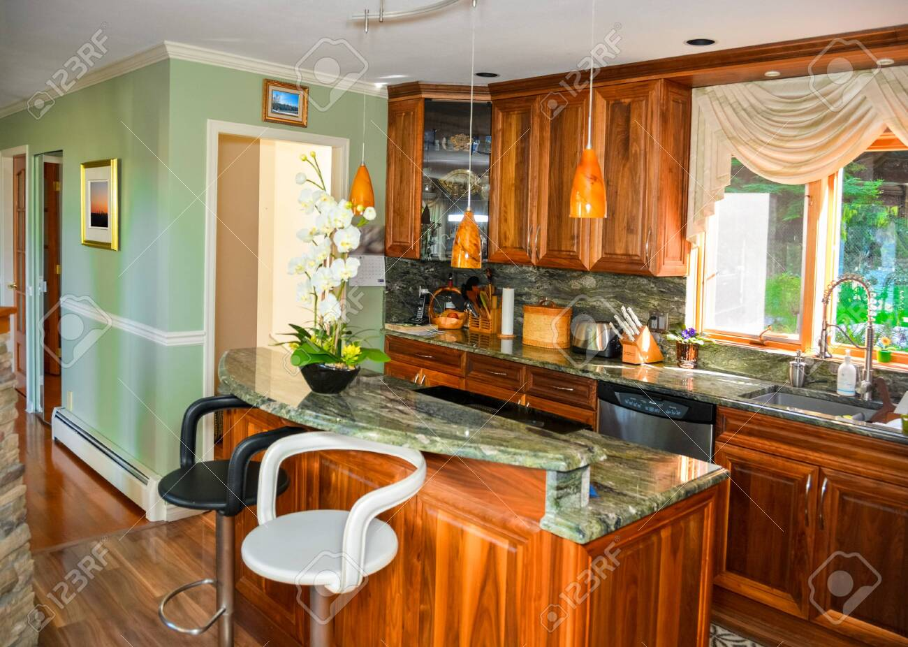Stylish Kitchen Wooden Interior With Island Table With Two Chairs Stock Photo Picture And Royalty Free Image Image 133170594