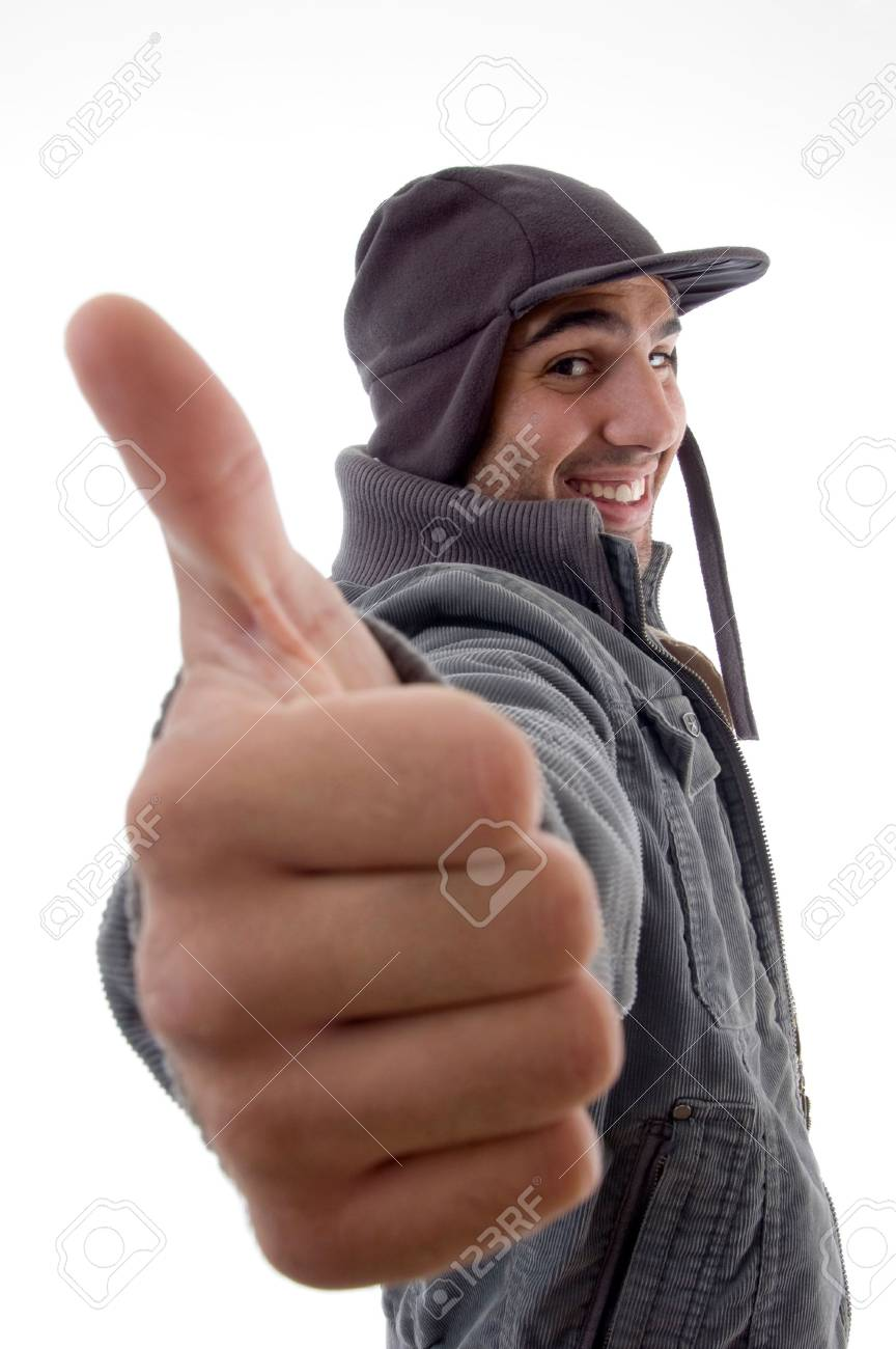 casual male model showing thumbs up on an isolated background Stock Photo - 3867385