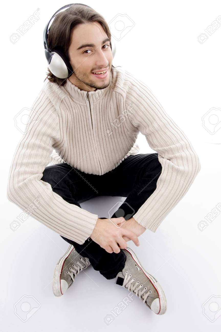 young handsome male listening to music with headphones against white background Stock Photo - 3975027