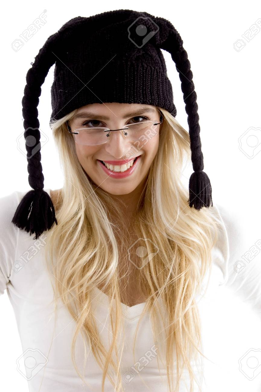 front view of smiling woman in woolen cap on an isolated background Stock Photo - 3975370