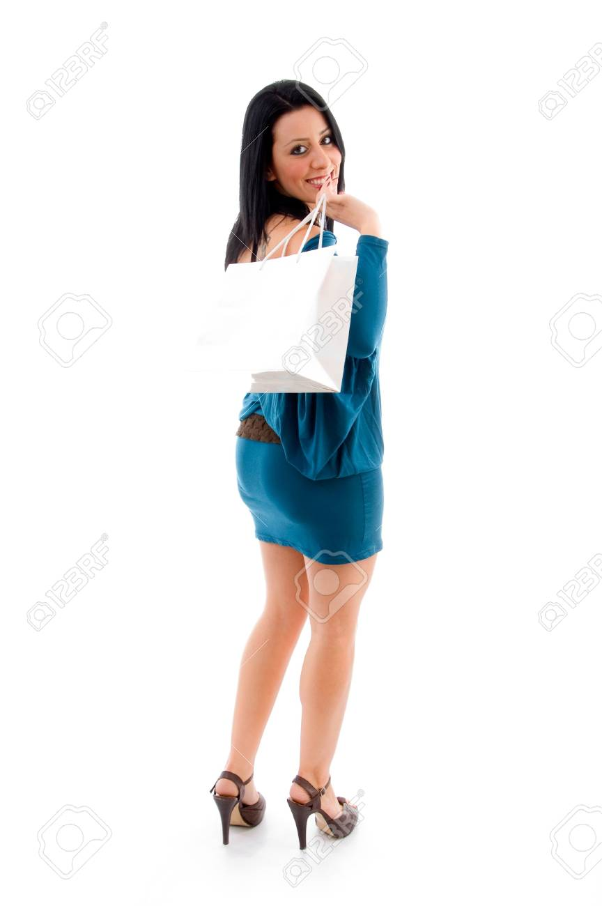 side view of female with shopping bags against white background Stock Photo - 4051405