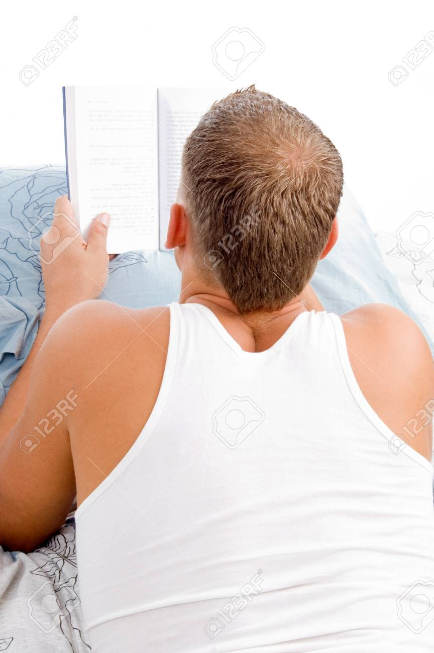 man reading book while resting on in bed Stock Photo - 4365526