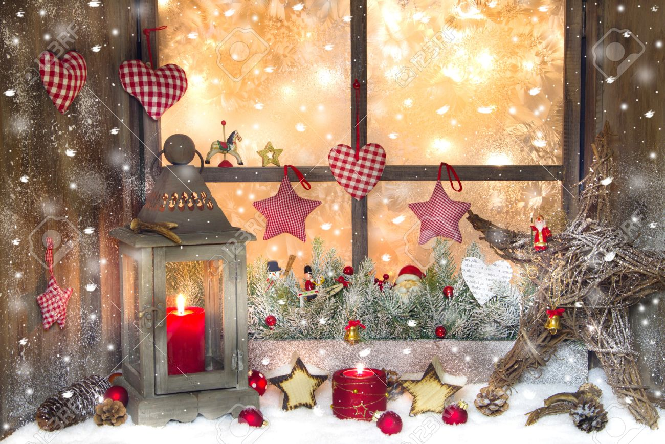 red christmas decoration with lantern on window sill stock photo 22570674