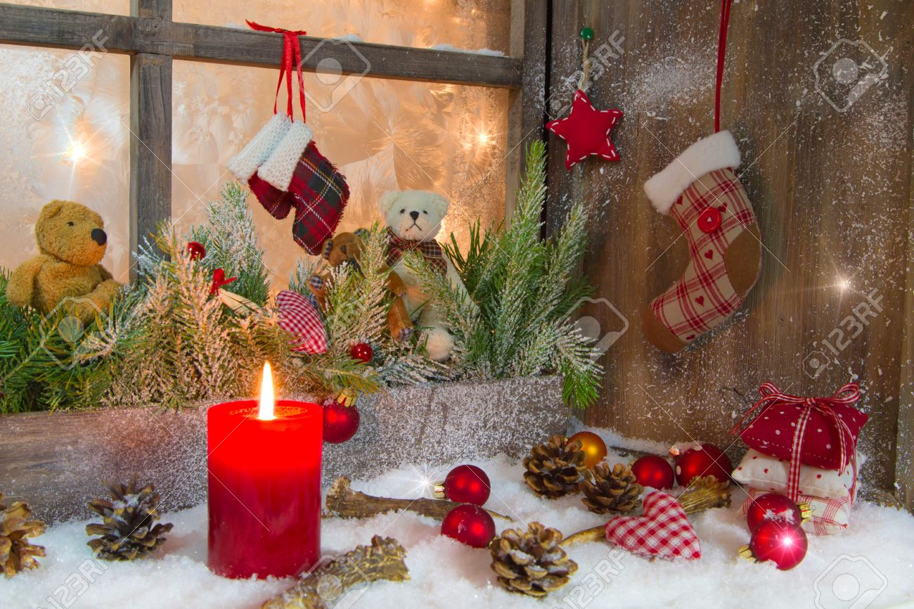 christmas decoration with red candle on window sill stock photo 22564673