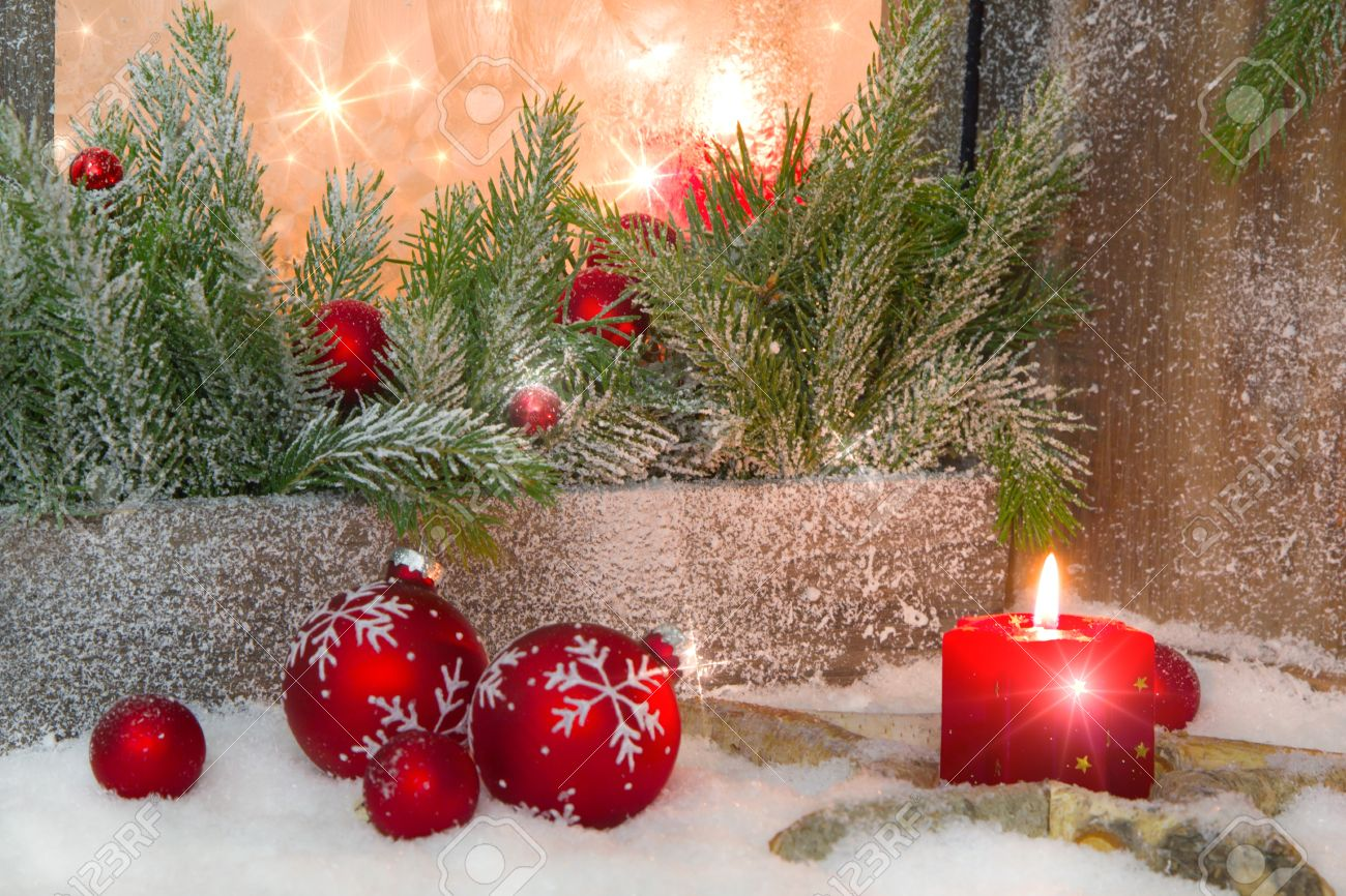 Red Christmas decoration on window sill