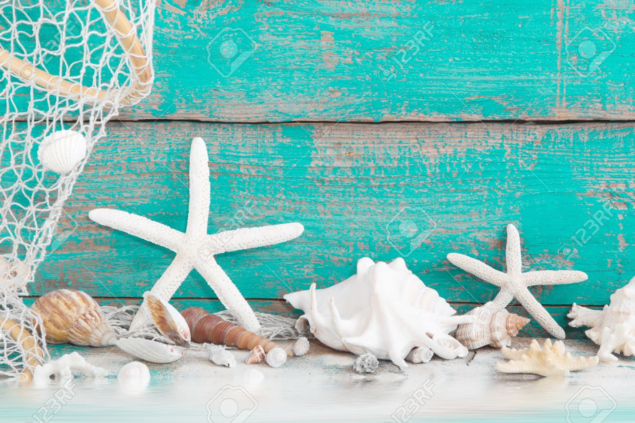 Maritime Decoration With Shells And Starfish On A Wooden Turquoise