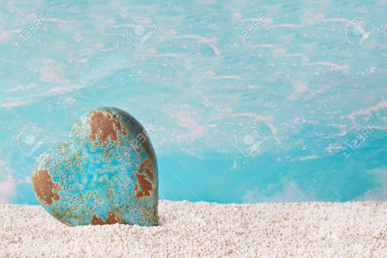 A Lone Heart In Turquoise On The Beach Decoration Maritime Stock
