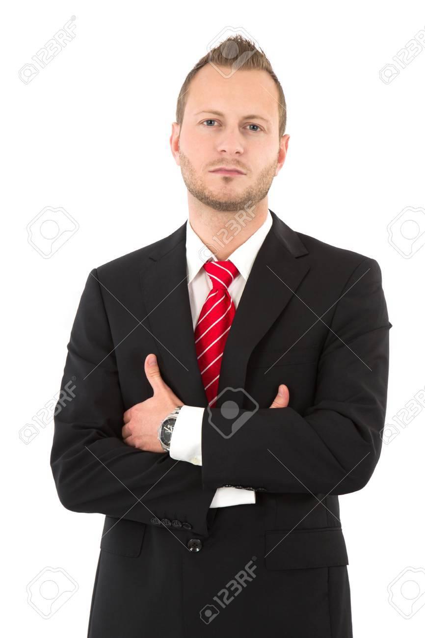 Ernstige manager in pak met gekruiste handen geïsoleerd op wit
