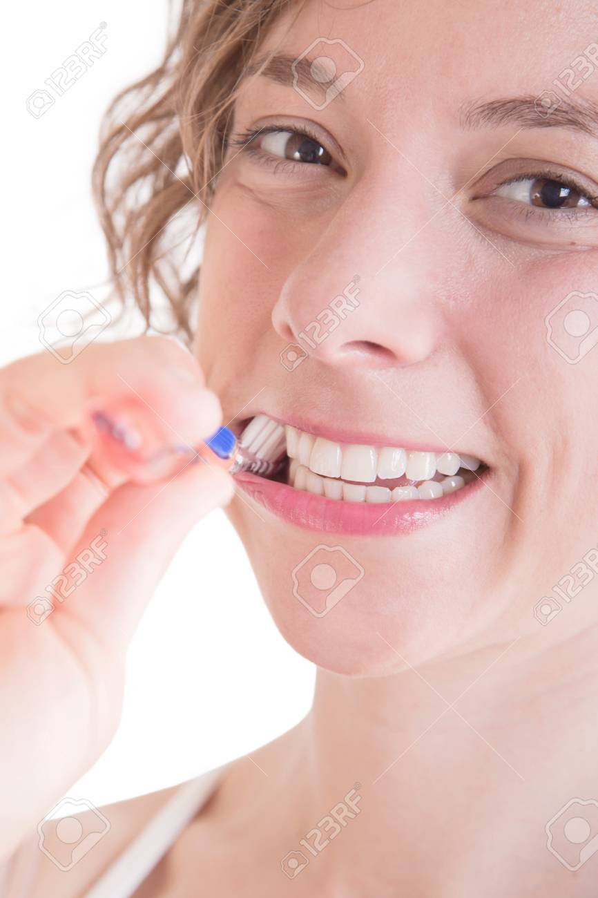White teeth - Woman with toothbrush isolated on white Stock Photo - 23796953