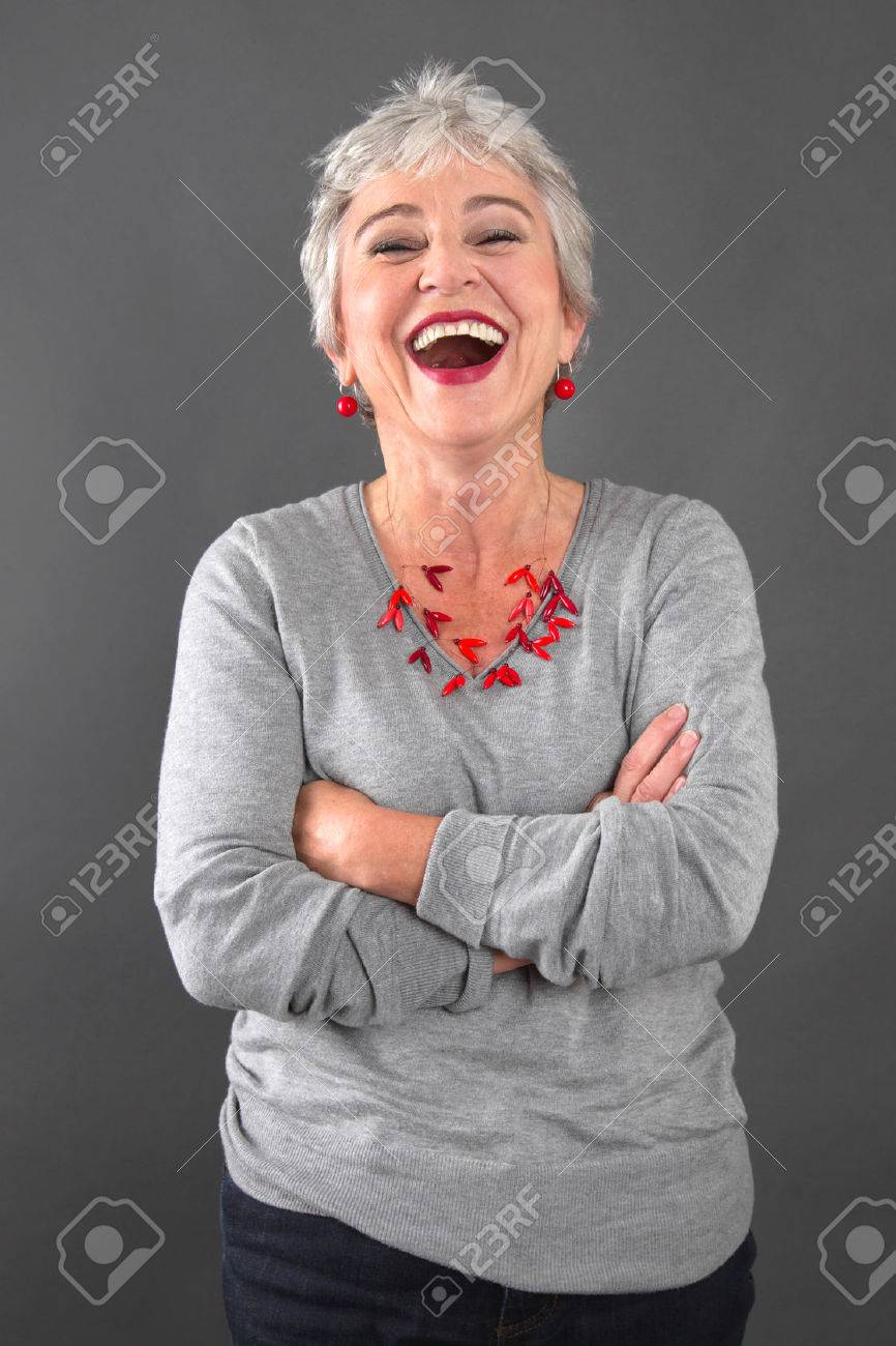 Smiling elderly lady in gray - 24409715