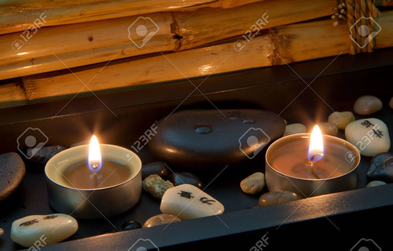 romantic candlelight with chinese or asian characters - spa