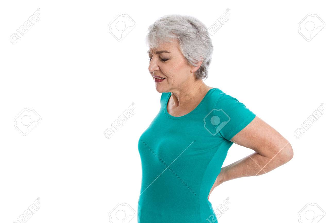 Isolated older woman in green shirt with backache. Stock Photo - 27626760