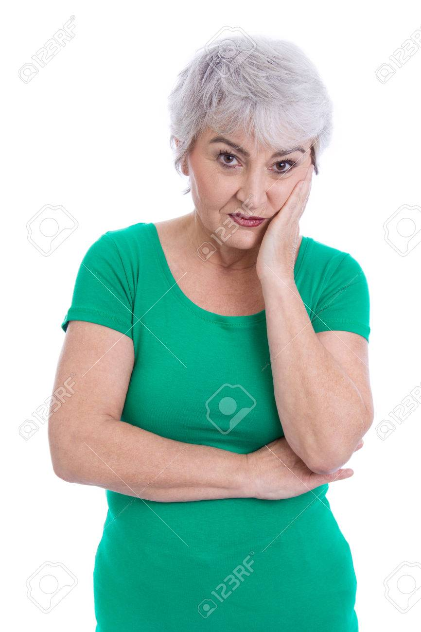 Pensive and sad elderly woman isolated on white. Stock Photo - 27626761