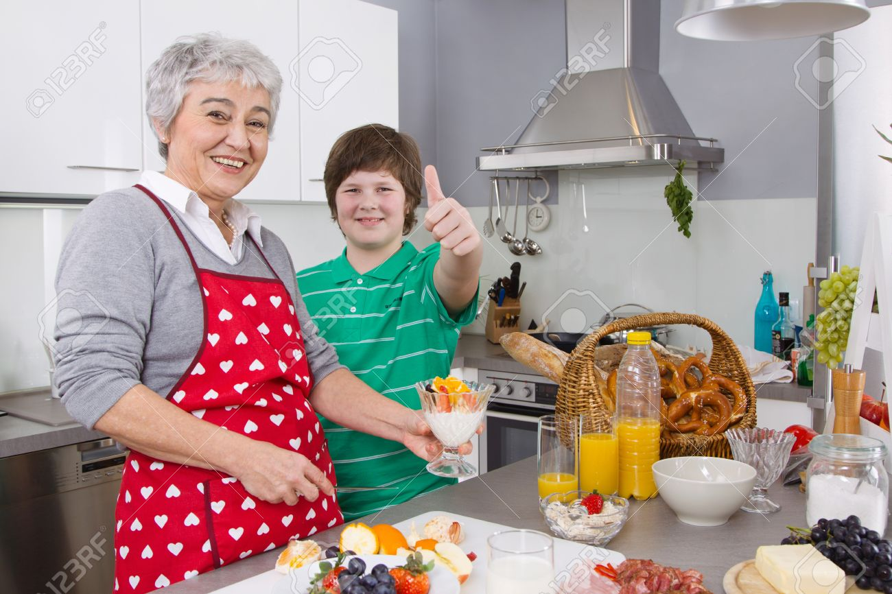 Family cooking kitchen - Happy Family Grandmother And Grandson Cooking Together In The Kitchen Stock Photo 29520851