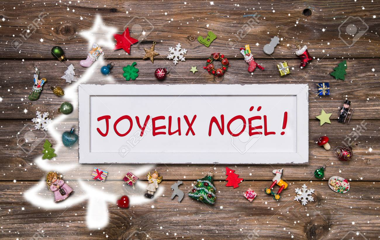 Merry christmas greeting card with french text decoration merry christmas greeting card with french text decoration multicolored with miniatures on wooden background with m4hsunfo Images