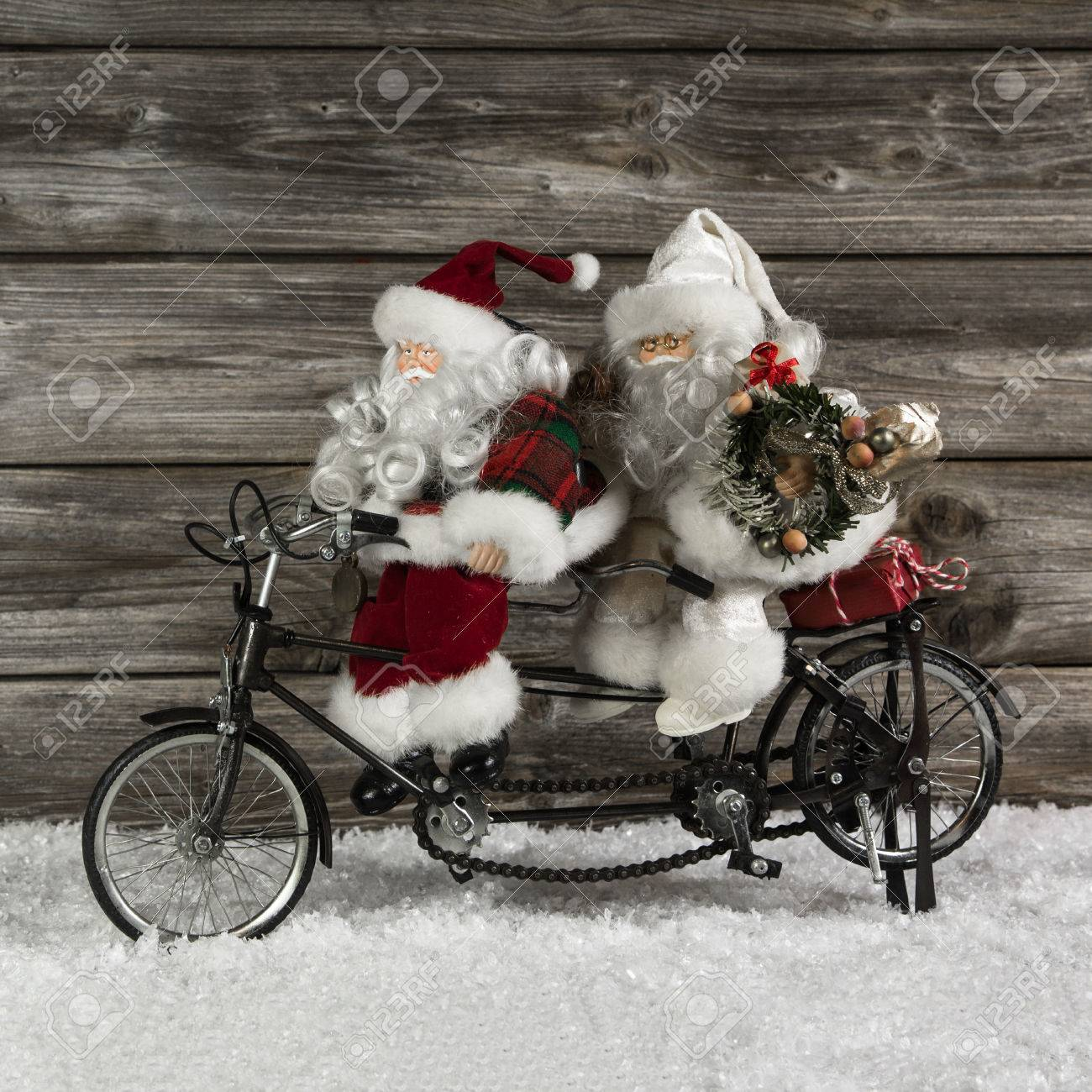 Two Funny Santa Claus On A Tandem In Hurry For Christmas Shopping ...