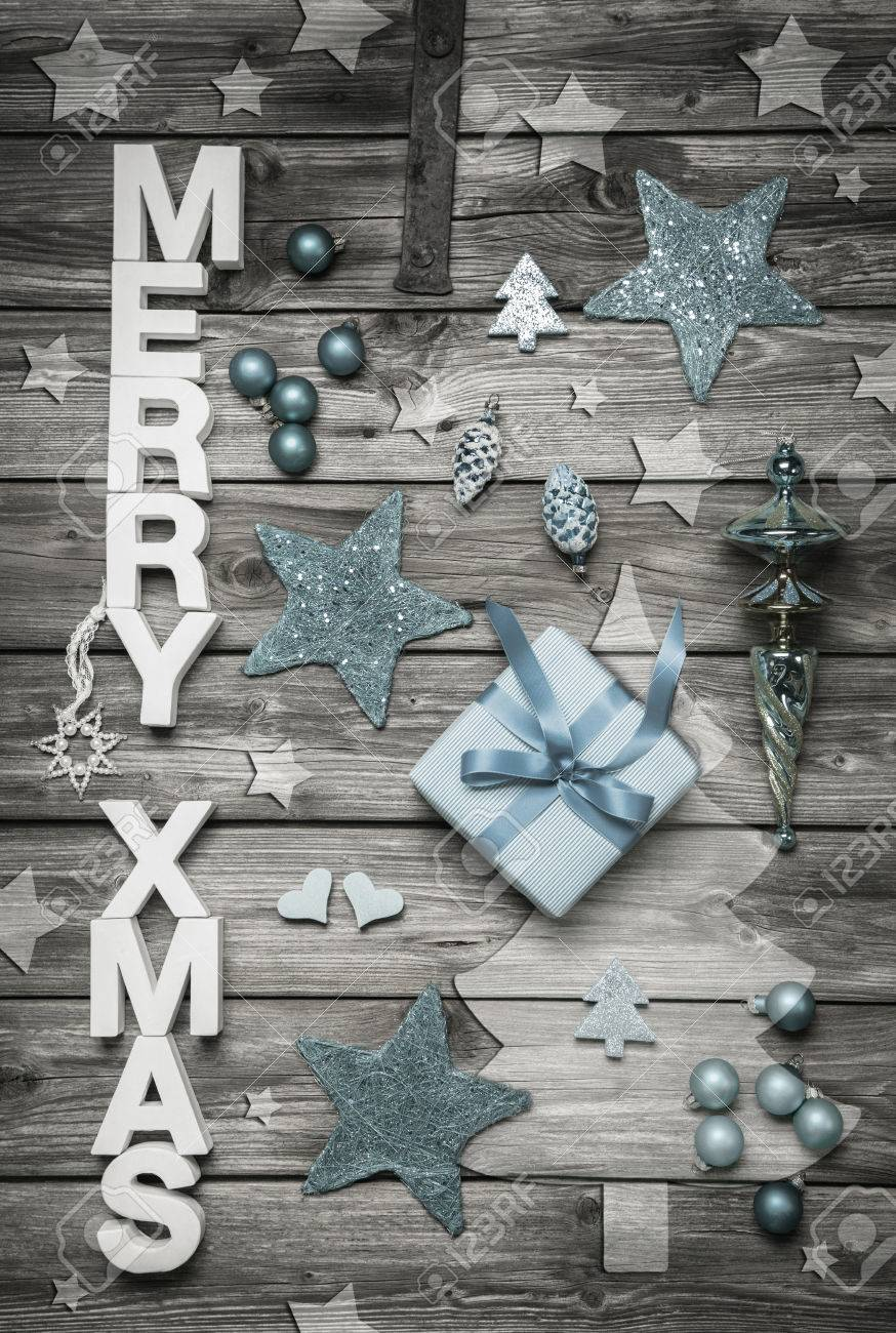 merry xmas christmas decoration in shabby chic style in light blue color with grey and white