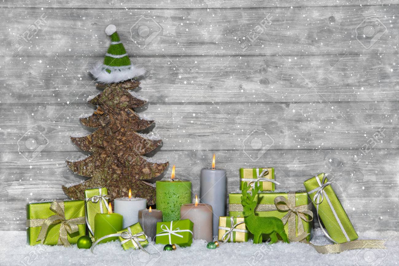 Shabby Chic Green And White Christmas Decoration On Grey Wooden ...