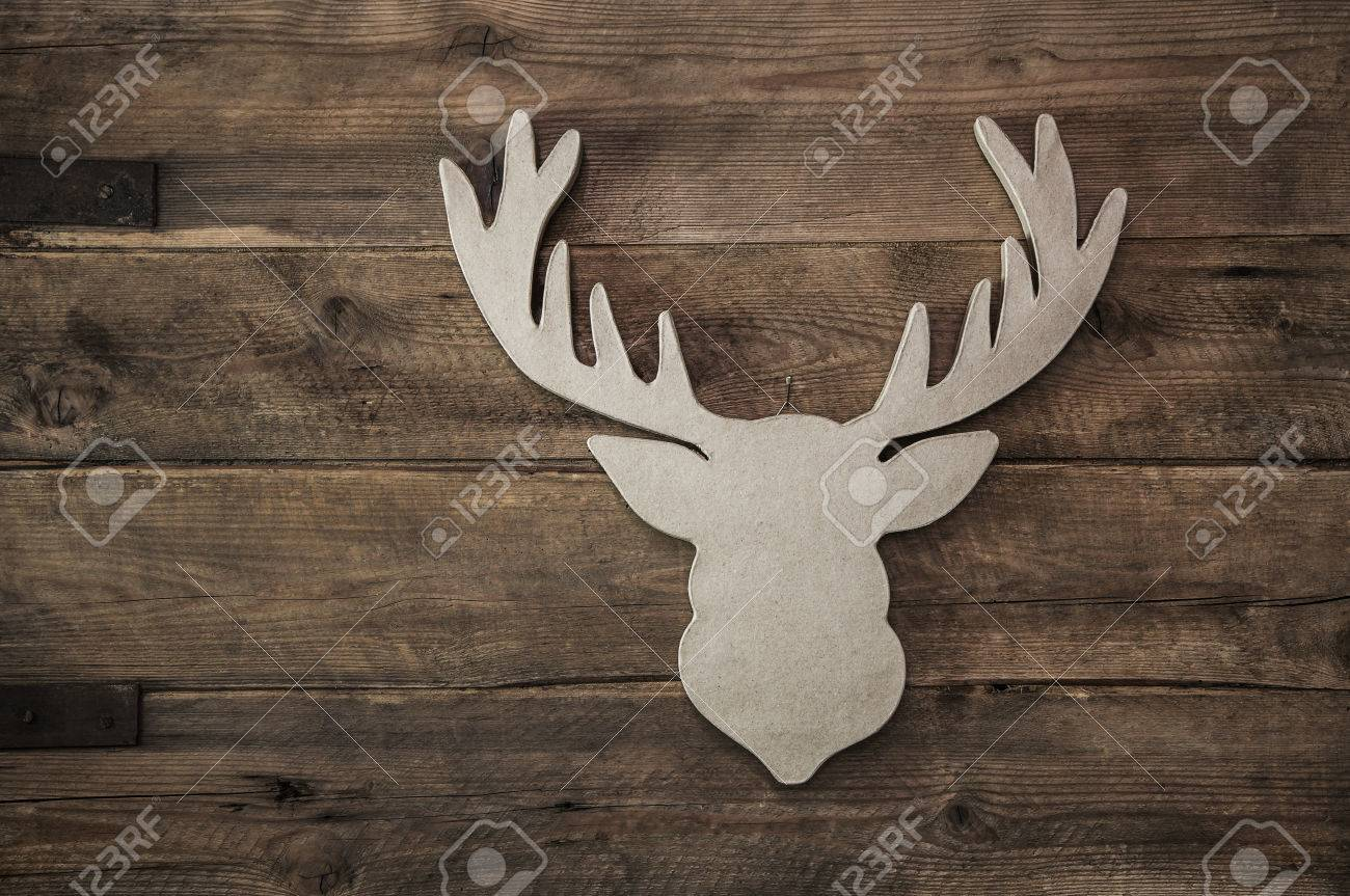 Vintage Rustic Christmas Decoration With Antler On Wooden Brown Background Stock Photo