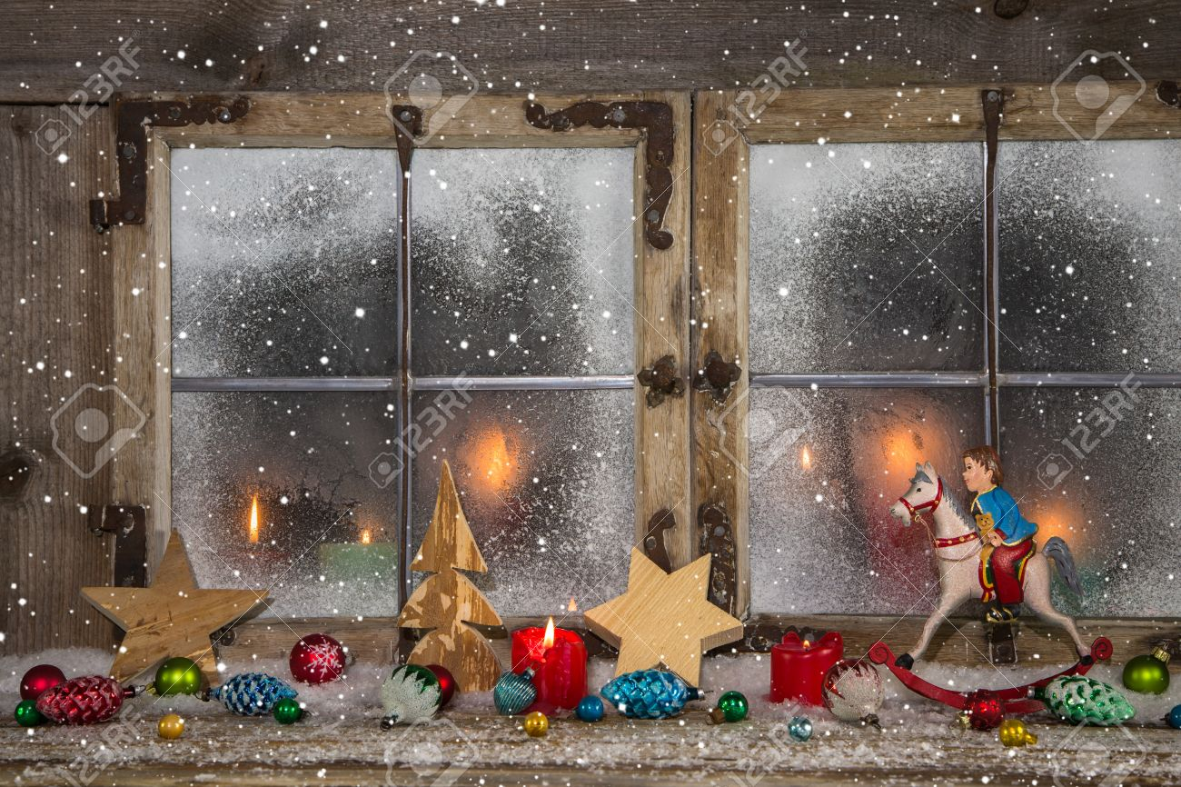 festive decorated wooden christmas window with candles and vintage decoration stock photo