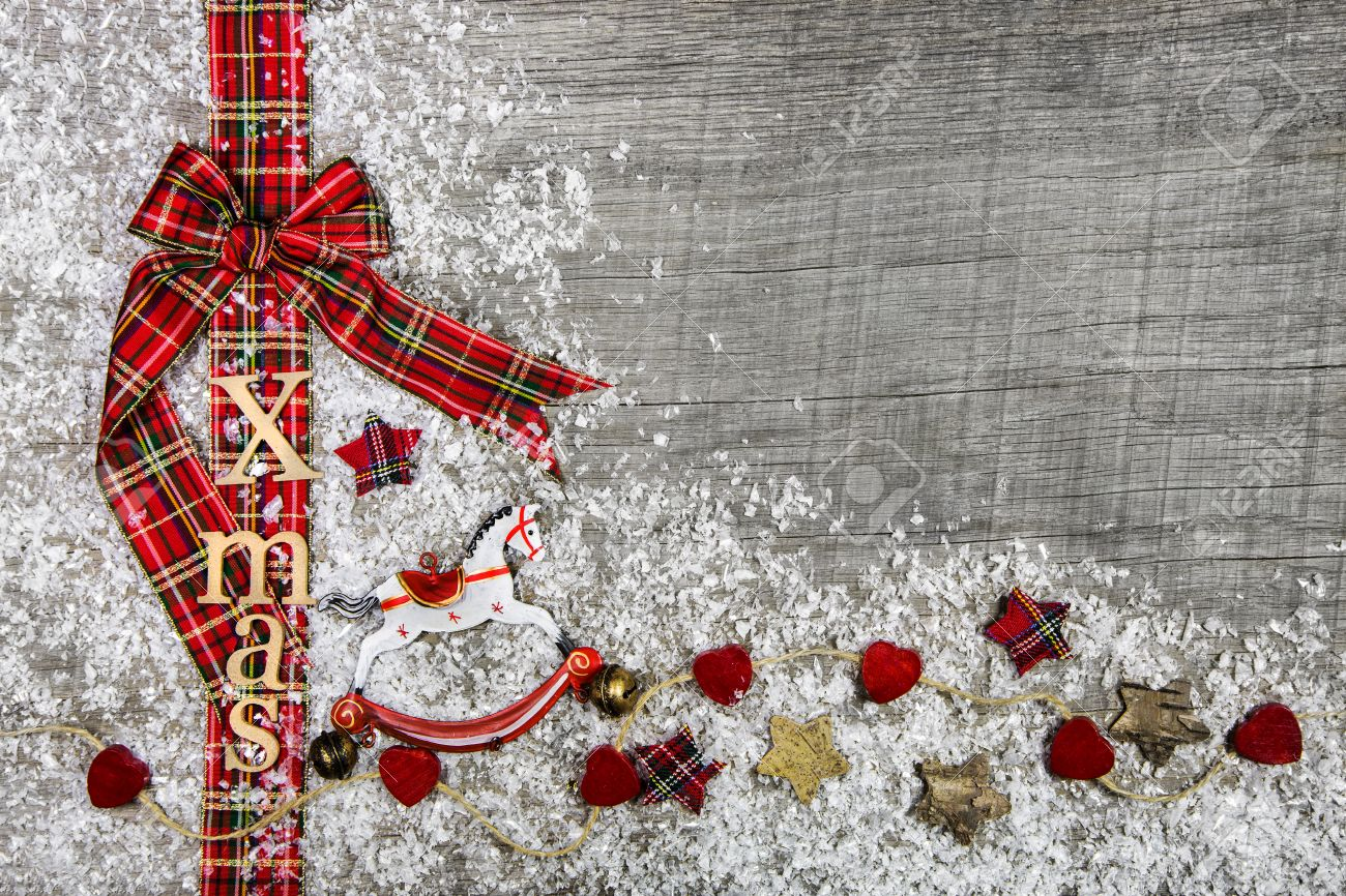 Country Style Christmas Background With Red Green Checked Ribbon On Wood Snow Stock Photo