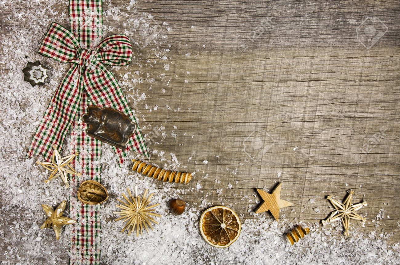 Country Style Christmas Background With Red And Green Checked Ribbon On Wood Stock Photo