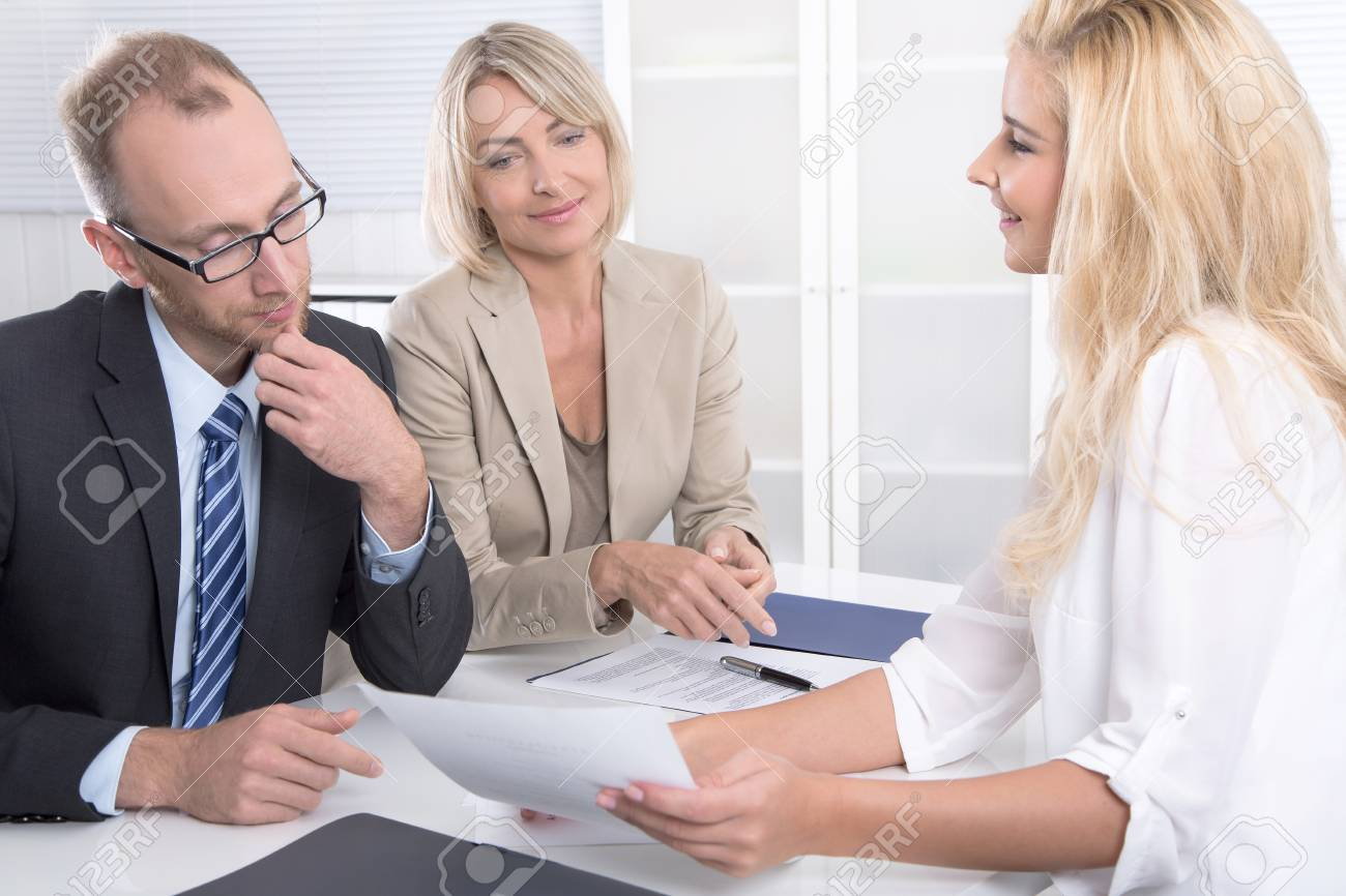 successful business team of man to woman sitting around a table