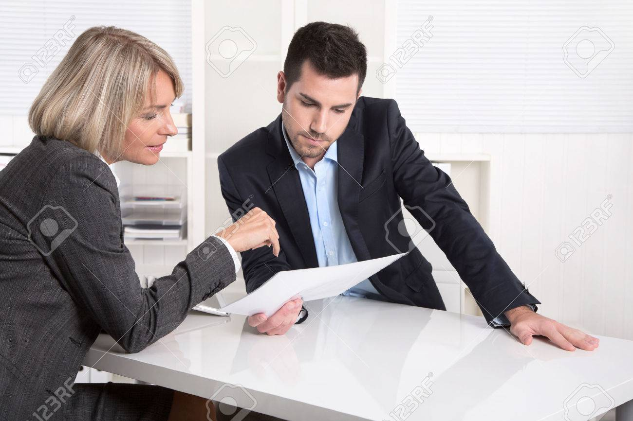 Business team in a meeting looking at a sheet of paper Banque d'images - 37909742