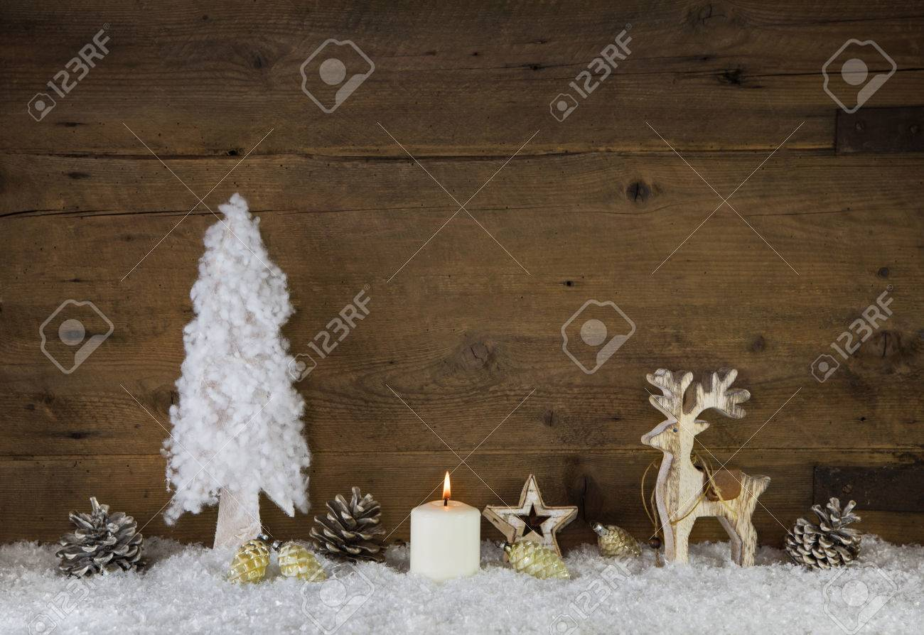 country style natural christmas decoration with reindeer in white and brown colors with candle stock