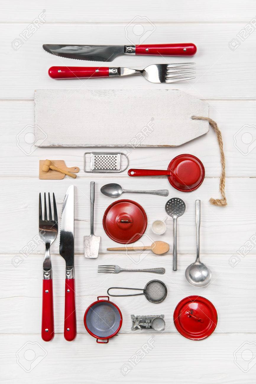 Red white menu for restaurants with old doll\'s kitchen utensils..
