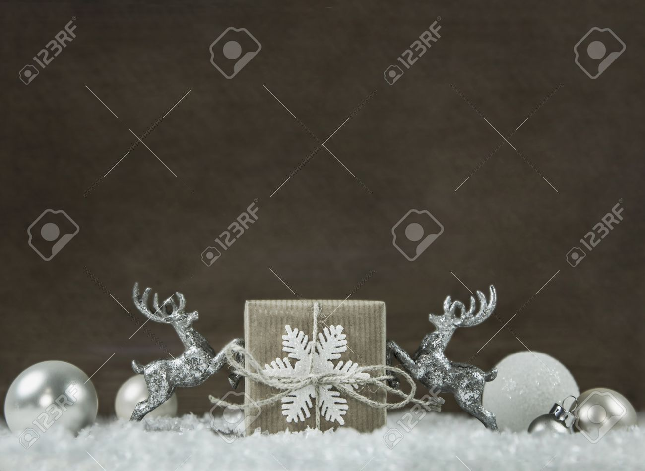 wooden shabby chic christmas background in silver white brown and grey colors with gift