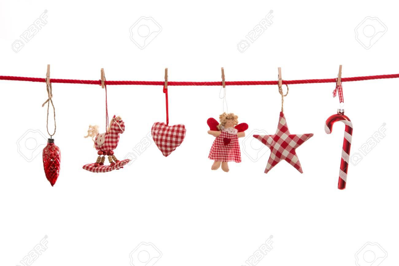 Kerstdecoraties Met Rood : Opknoping rood wit geblokte kerstdecoratie geïsoleerd op de