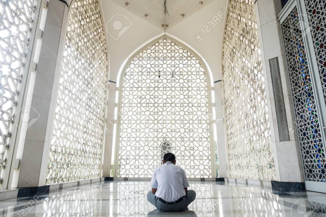 unknown muslim man praying at at a mosque reflection of islamic