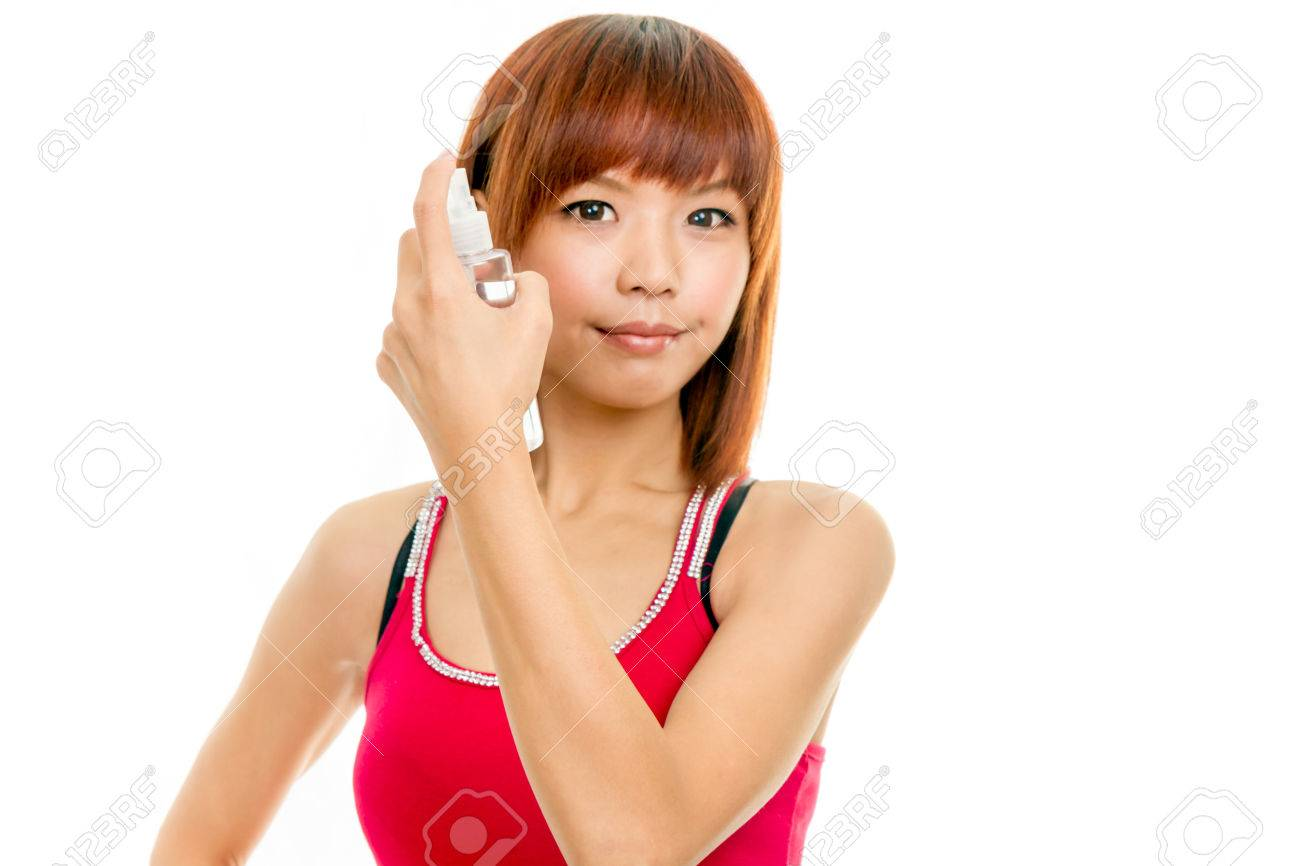 Chinese woman with spray bottle spraying hair - 23361249
