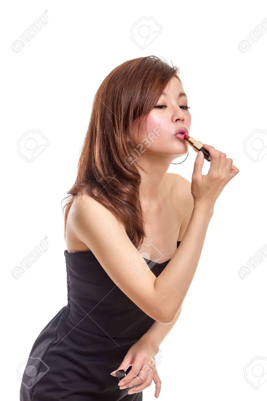 Black dress lipstick - Chinese Woman In Black Dress Putting On Lipstick Stock Photo 33809263