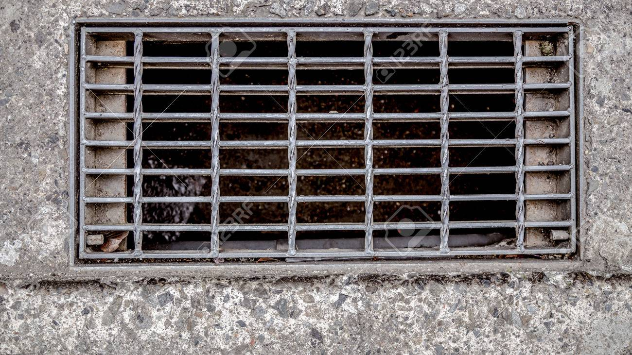 Sewer cover or storm drain in street - 35601461
