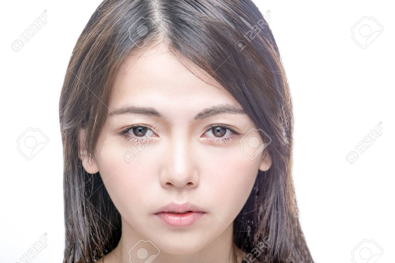 Beautiful Asian woman with perfect skin . Healthy skincare concept looking at camera. - 39029087