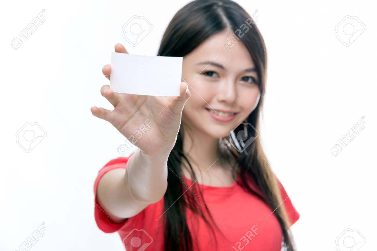Out of focus Chinese woman holding up business card, left blank for copy space - 41117657