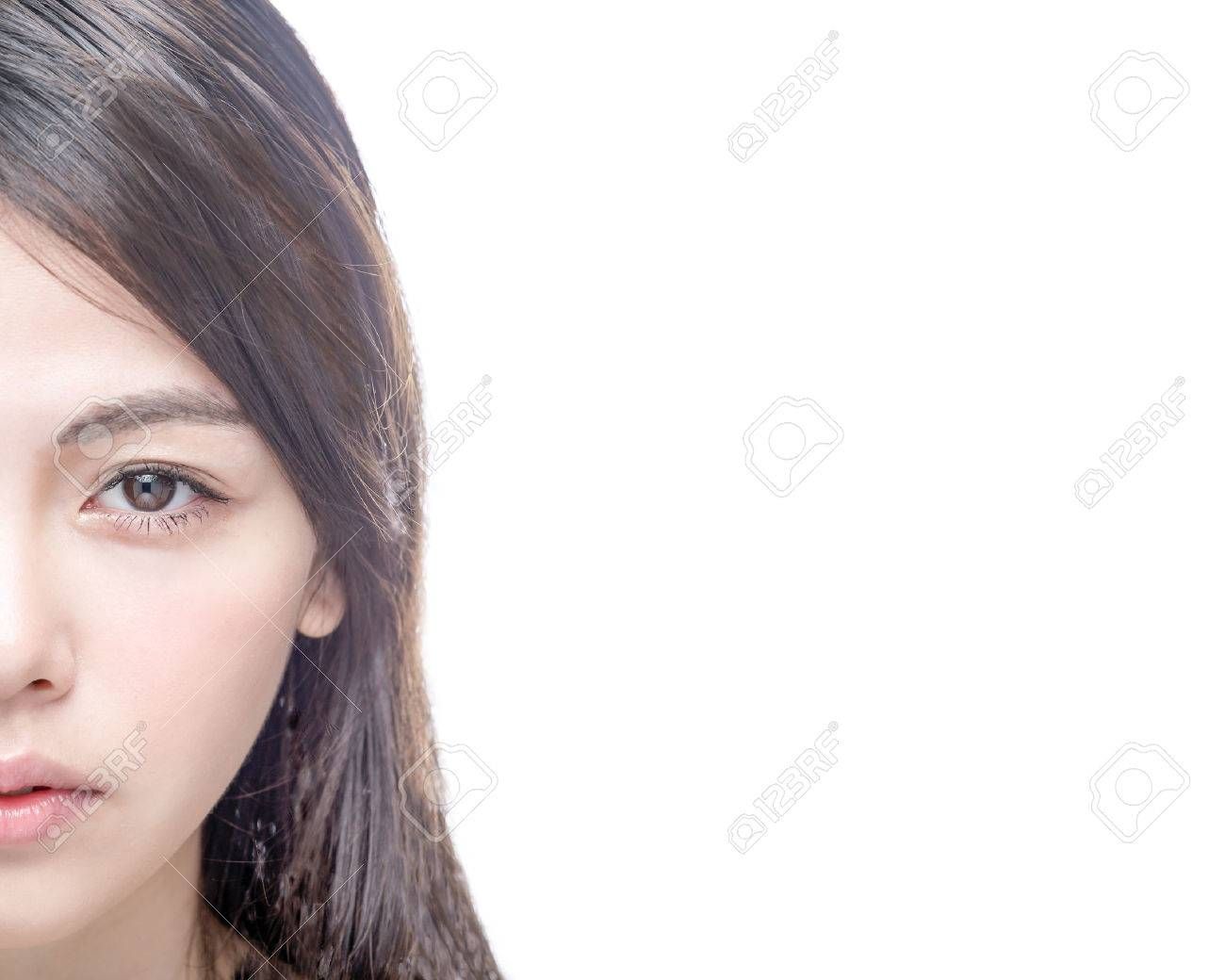 Half of Chinese Asian female face isolated on white background - 43008147