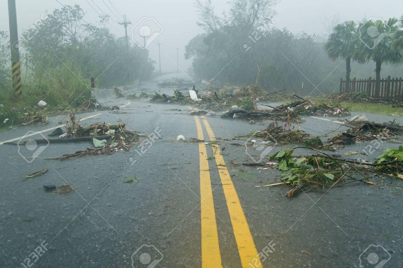 Debri blocking road during a typhoon - 44728466