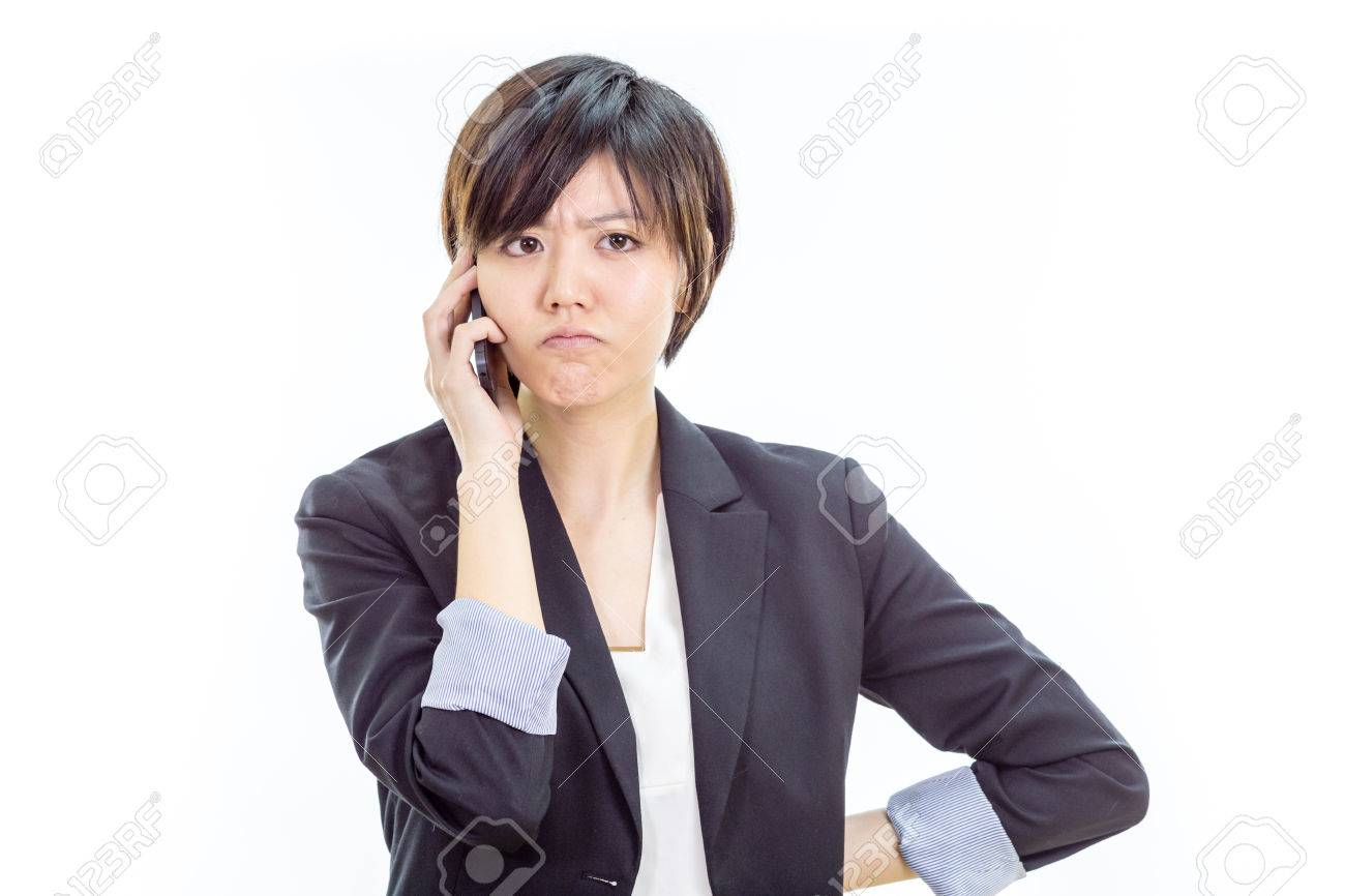 Chinese businesswoman in casual office clothes on cell phone looking annoyed - 52522019