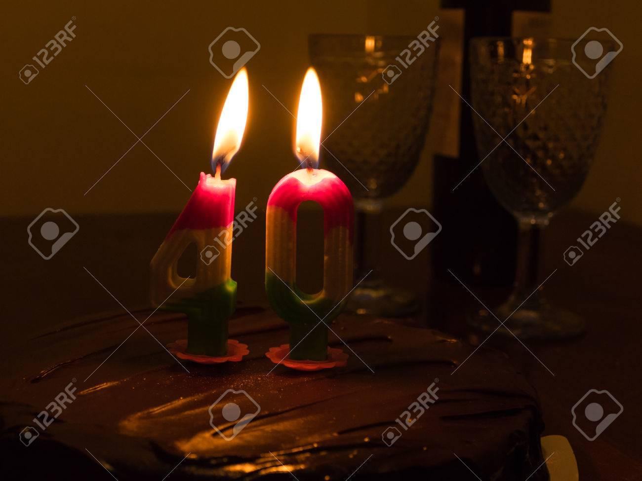 Chocolate Birthday Cake With Burning 40 Candle Stock Photo
