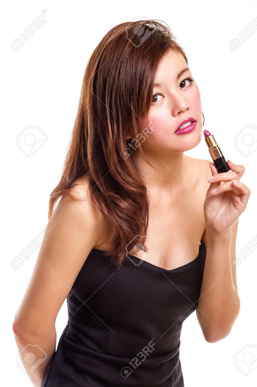 Black dress lipstick - Chinese Woman In Black Dress Putting On Lipstick Stock Photo 80026718