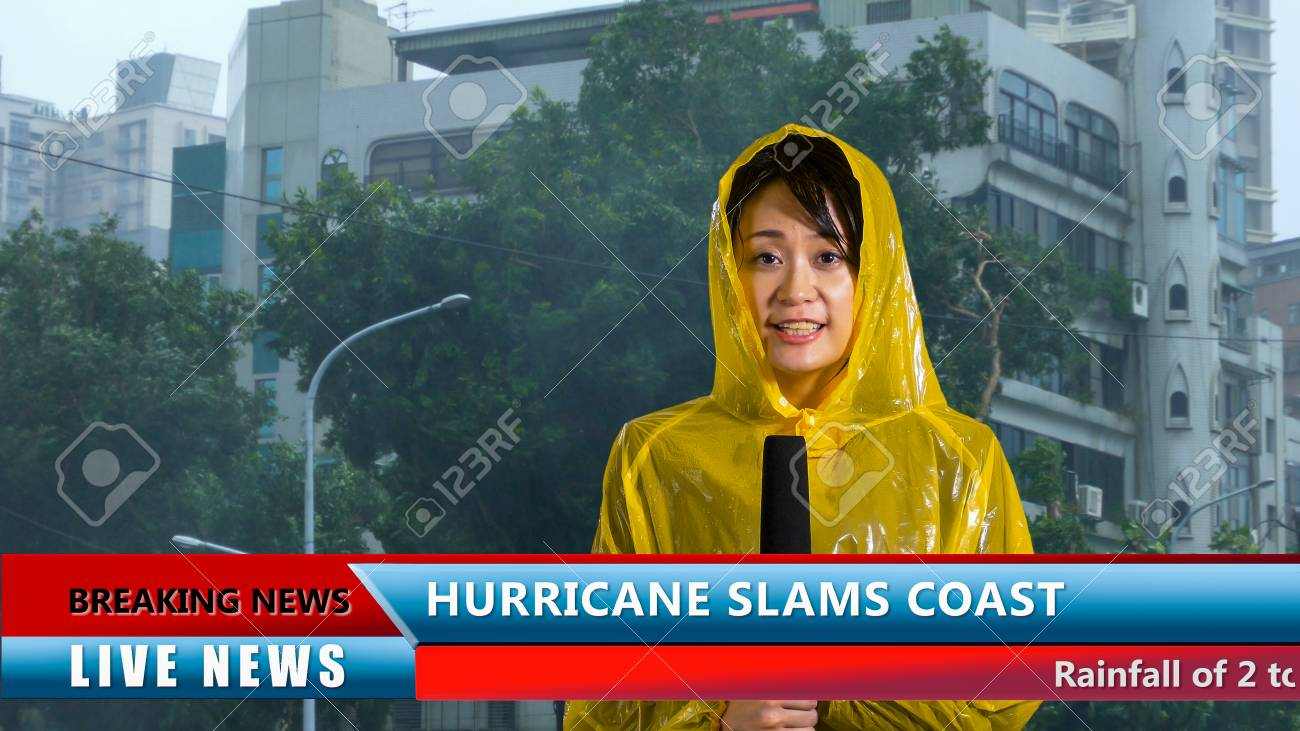 Asian American weather reporter live report in storm - 91439082
