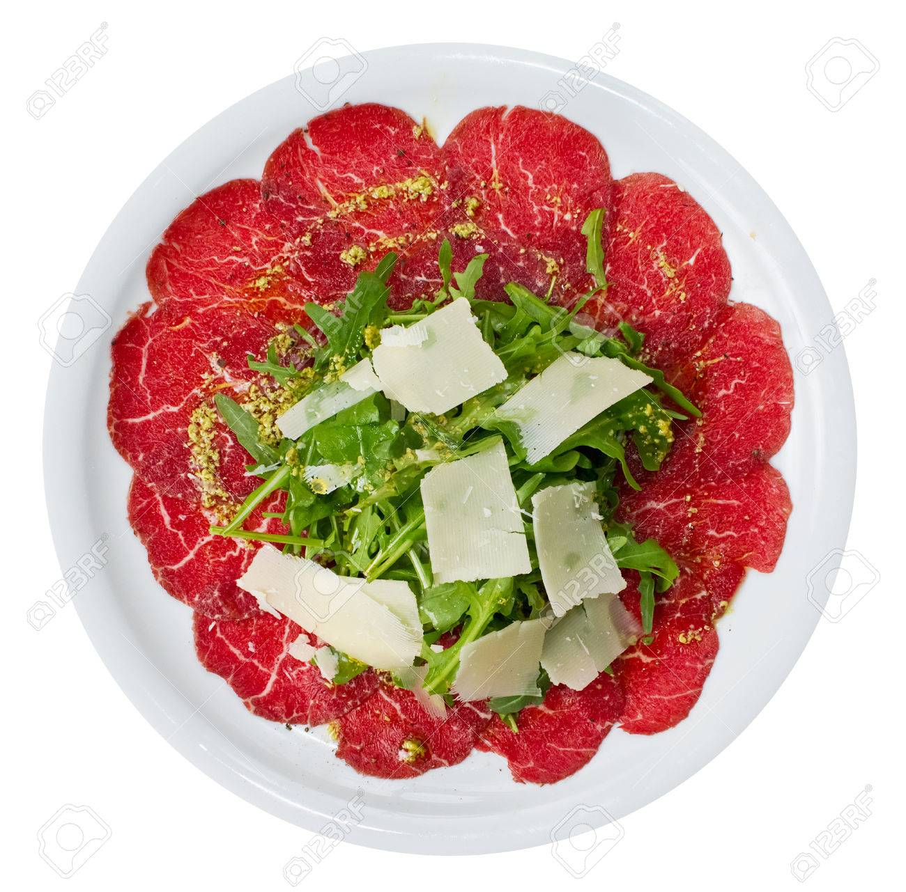 Carpaccio is a dish of raw meat  (such as beef, veal or venison), thinly sliced or pounded thin and served mainly as an appetizer. Standard-Bild - 23115154