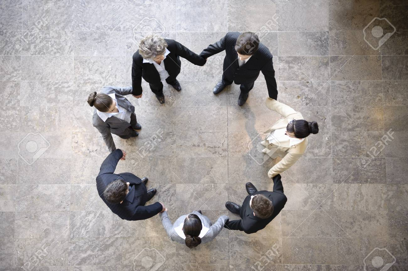 Business people holding hands in circle - 85954405