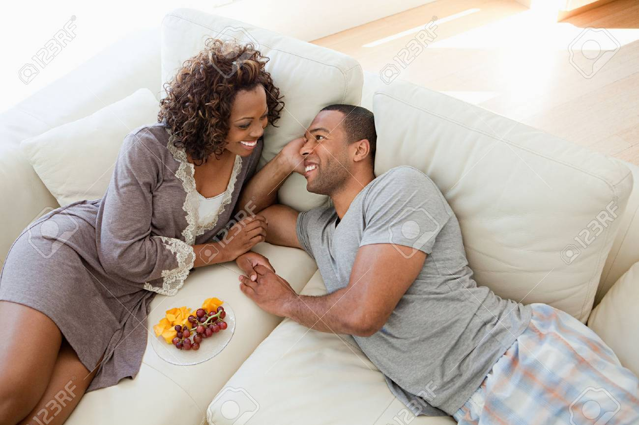 Young couple relaxing on sofa - 86036734