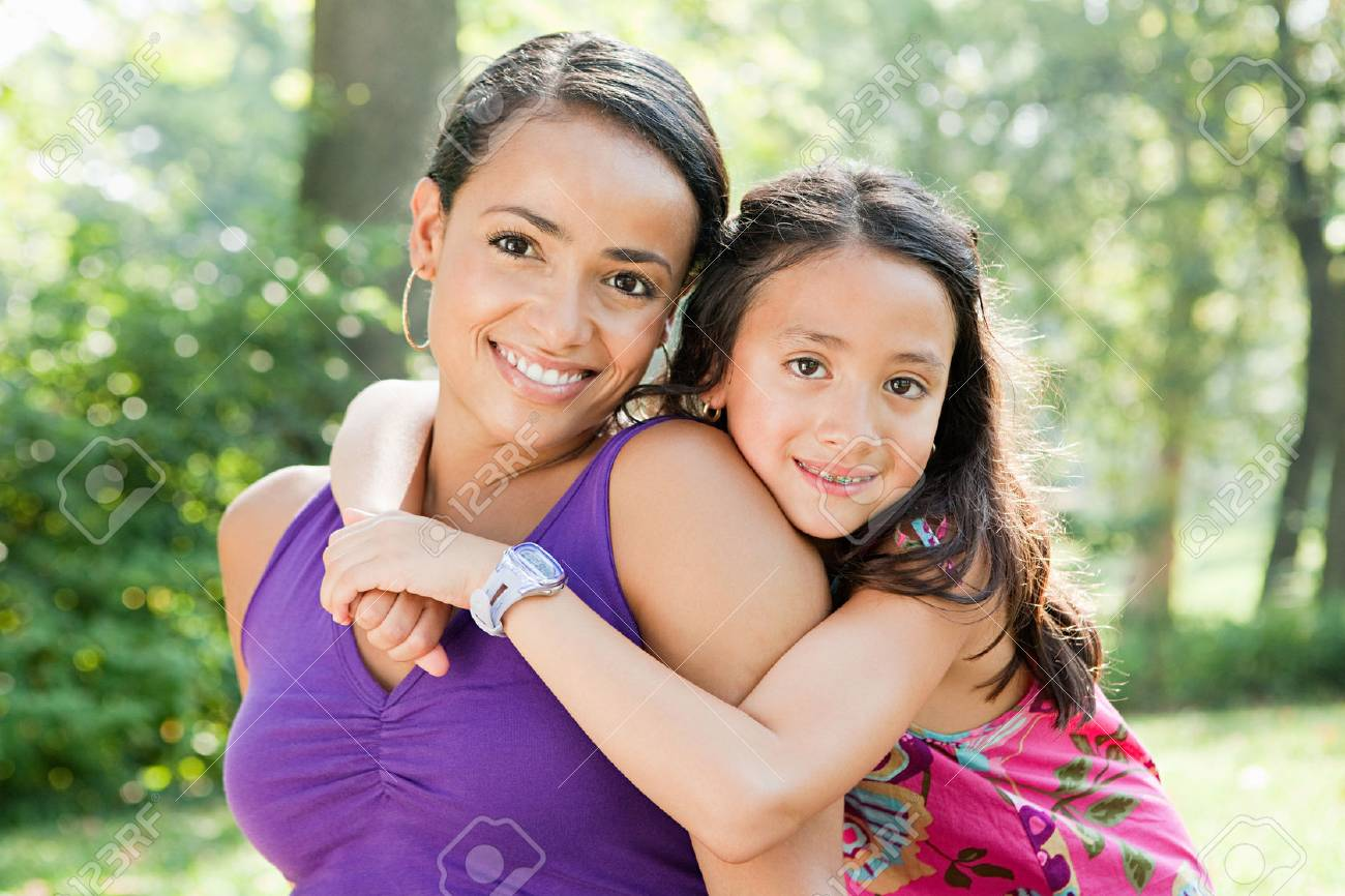 Mother and daughter smiling in park, portrait - 85954706