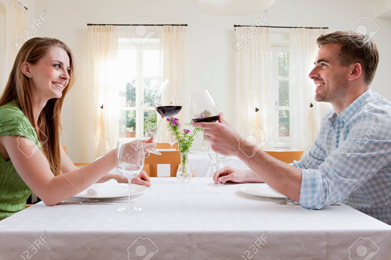 Couple at restaurant toasting with wine - 114160257