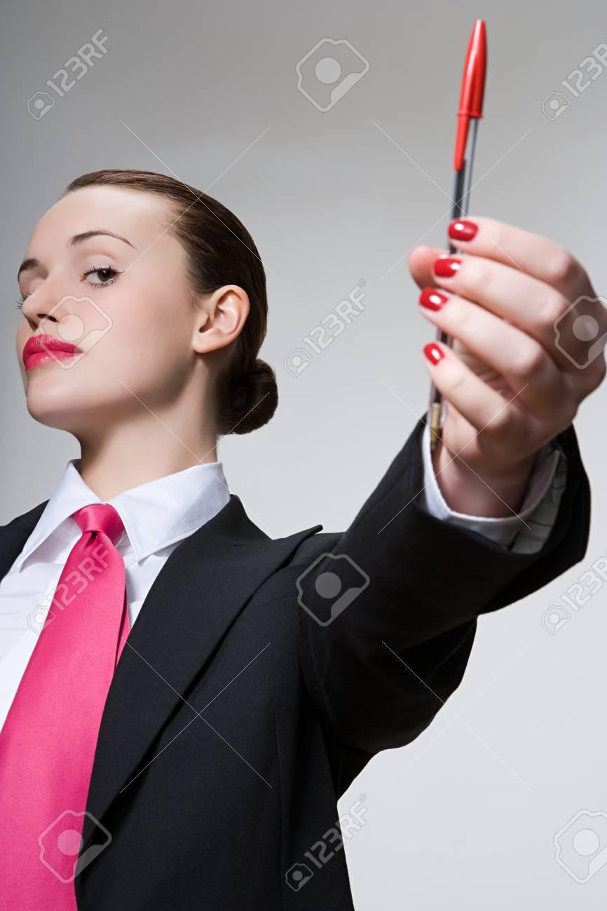 Woman holding a pen - 125559422